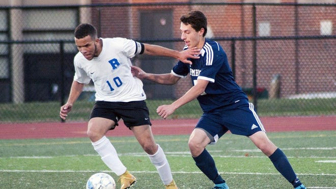 There will be boys soccer this season, but it may look a little different than the past. Here, Randolph captain Saddraque Ferraz, a league MVP, fights for the ball in a previous season.