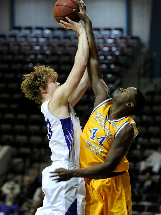 McNeese State's Austin Lewis (44) blocks the shot of Abilene Christian's Hayden Howell (23) during the first half of an NCAA basketball game, Tuesday, Jan. 19, 2016, at ACU's Moody Coliseum, in Abilene, Texas. Abilene Christian won the game 75-67. (Tommy Metthe/Abilene Reporter-News via AP)
