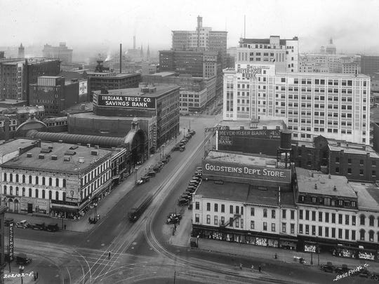 Indianapolis downtown looking west on Washington St. in 1927. The tower on the Merchants Bank building can be seen in the middle as can the pollution.