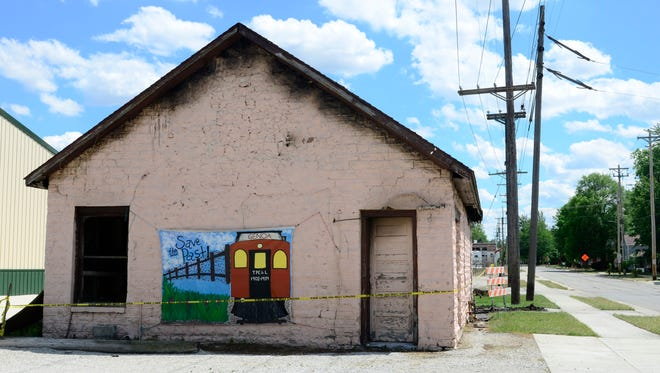 The historic stone depot in Genoa, severely damaged in an arson fire on June 8, is scheduled for demolition.