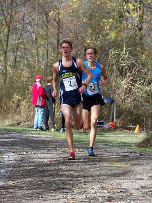 Algonac's Morgan Beadlescomb (left) and St. Clair's Jack Keais (right) run at the Division 2 regional meet at Algonac on Oct. 30.