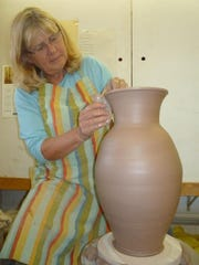 Jeanne Aurelius of Clay Bay Pottery in Ellison Bay shapes a clay vase on the potter's wheel during a demonstration at the gallery. Clay Bay is one of the locations taking part in this weekend's Ellison Bay Spring Art Crawl.
