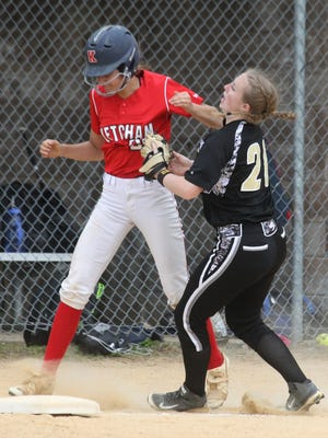 Clarkstown South's Megan Keaveney Keaveney takes an elbow to the chin as she tags out Ketcham's Cassi Kielb during their Section 1 Class AA softball tournament first round game at Clarkstown South May 20, 2017. Clarkstown South won 5-4.