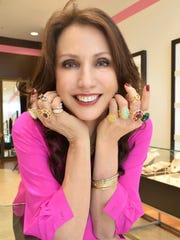 Erica Courtney poses with some of her jewelry designs at Kiki in River Ranch.