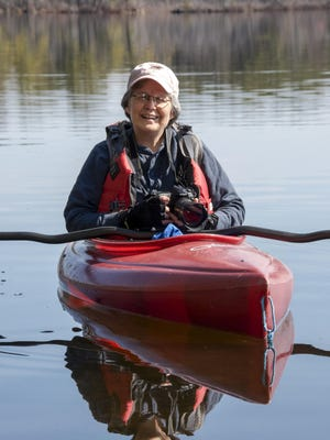 F.C. West followed the lives of loons from her kayak.