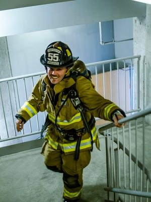 A Windsor Heights firefighter sprinting up the stairs at the Fight for Air Climb.