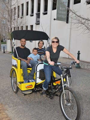 Jessie Lehmann pedaled customers around downtown Asheville for three years. Now her business Asheville Bike Taxi is for sale.