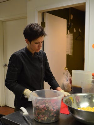 Ashley Shreffler, an employee at Homemade.Delivered., preps ingredients for a beef and pinto chili.
