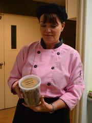 Denise LeBolt, owner of Homemade. Delivered., holds