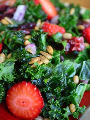 Kale, dried cranberries, red onion, raspberry dressing, strawberries and honey roasted sunflower seeds make this 24 Hour Kale Salad an explosion of flavor. It must marinate for 24 hours.