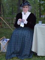 Kathryn Ross of Vineland, a member of the Friends of Vineland, relaxes during Camp by Candlelight, the only Founder's Day event that was not canceled due to forecasted heavy rain. Photo/Jodi Streahle