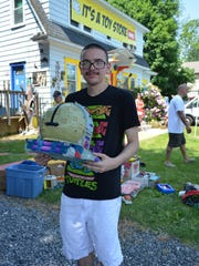 Jorge Fornia of Egg Harbor City is pictured with the Teenage Mutant Ninja Turtles Technodrome that he found at the Richland Village Toy Show on Saturday, May 28. Photo/Jodi Streahle