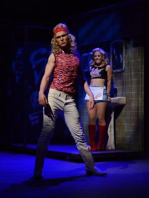 "Joe Ogren as Stacee Jaxx and Laurie Elizabeth Gardner as Sherrie Christian in Arizona Broadway Theatre's ""Rock of Ages."""
