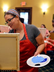 """Katie Schamburek leads a class during a """"Picasso and Pub"""" night at the Courthouse Pub on Monday, July 18."""