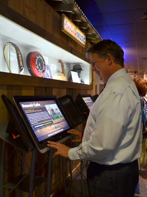 Mayor-President Joel Robideaux explores new Acadiana Music exhibit featuring memorbelia and interactive media honoring local musicians unveiled at the Lafayette Science Museum on August 11, 2016.