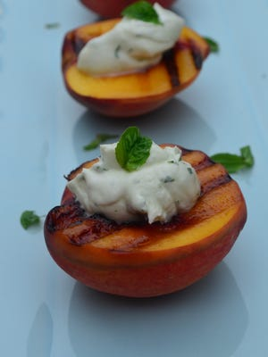 Grilled Peaches with Basil Cream is one of my husband's all-time favorite desserts. Fresh summer peaches are quickly grilled and topped with cool refreshing whipped cream seasoned with basil. It may sound odd, but it's incredible.