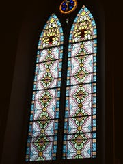 Original stained-glass windows and other historic touches are still found inside the former St. Luke's Church in Two Rivers.