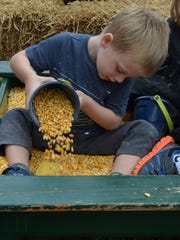 Lee Elwell, 3, of Greenwich plays in a sand box that