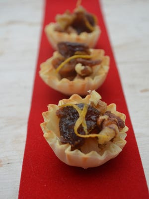 These Sherry Date Bites are a version of a dip I make. You can serve a variety of dips in these shells so party-goers can grab and snack.
