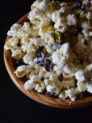 This White Chocolate Pistachio Cranberry Popcorn is sweet, salty and addictive. It's quick, easy and requires no cooking skills. It's perfect for a New Year's Eve soiree.