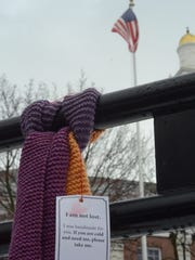 The last scarf hangs in City Hall Park in Burlington,