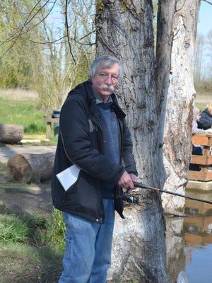 Henry Miller fishes at Pond 6 at St. Louis Ponds.