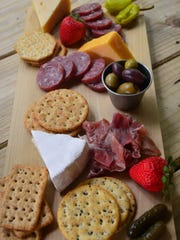 Thor Bersteds made the charcuterie platters. This platter has brie, gouda, cheddar cheese, salami, crackers and olives ($15).