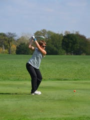 Shelby sophomore Julia Gutchall hits a drive during Friday's first round of the Division II state girls golf tournament on Ohio State's Gray Course.