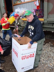 Operation Toy Train in Oakland in 2012. Military Transport volunteers assist with loading toys.