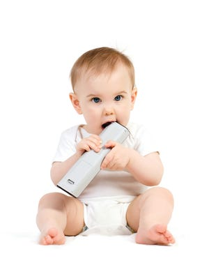 This baby really loves the remote control.