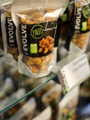 A snack item is shown inside an Evolve Juicery and Paleo Kitchen.