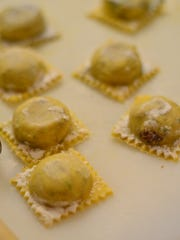 Freshly crafted raviolis were ready to be cooked during