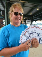 Pick a card, any card, says Sharon Sims, president