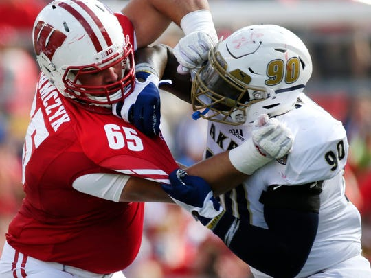 Wisconsin offensive lineman Ryan Ramczyk (left) is