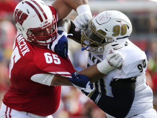 Wisconsin left tackle Ryan Ramczyk, left, projects