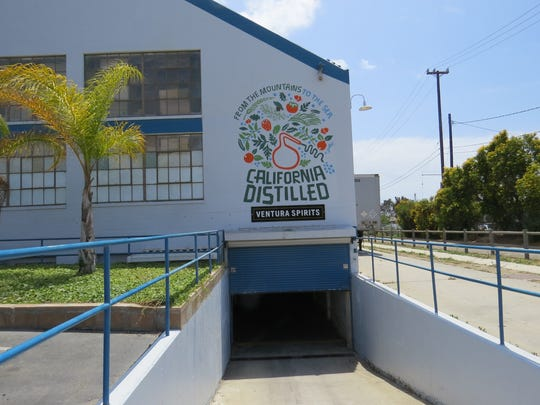 The Ventura Spirits distillery is located in the basement of a former warehouse building at Orchard Drive and Ventura Avenue in Ventura. Visitors enter through a roll-up metal door at the bottom of a loading ramp.