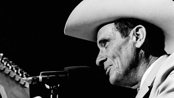 Ernest Tubb perform for the crowd during the WSM Friday night Opry during the 42nd anniversary of the Grand Ole Opry celebration at the Ryman Auditorium.