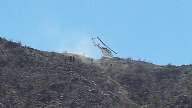A hiker who suffered heat-related injuries is airlifted off the Bump and Grind trail in 2012.