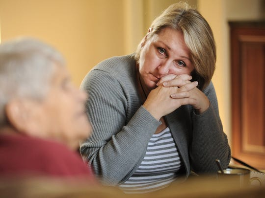 Linda Grigg Gerdes listens to her mother Nina Grigg as she talks about her time served in a Nazi slave labor camp in World War II. Photo taken 11/18/2014 by Greg DeRuiter/Lansing State Journal