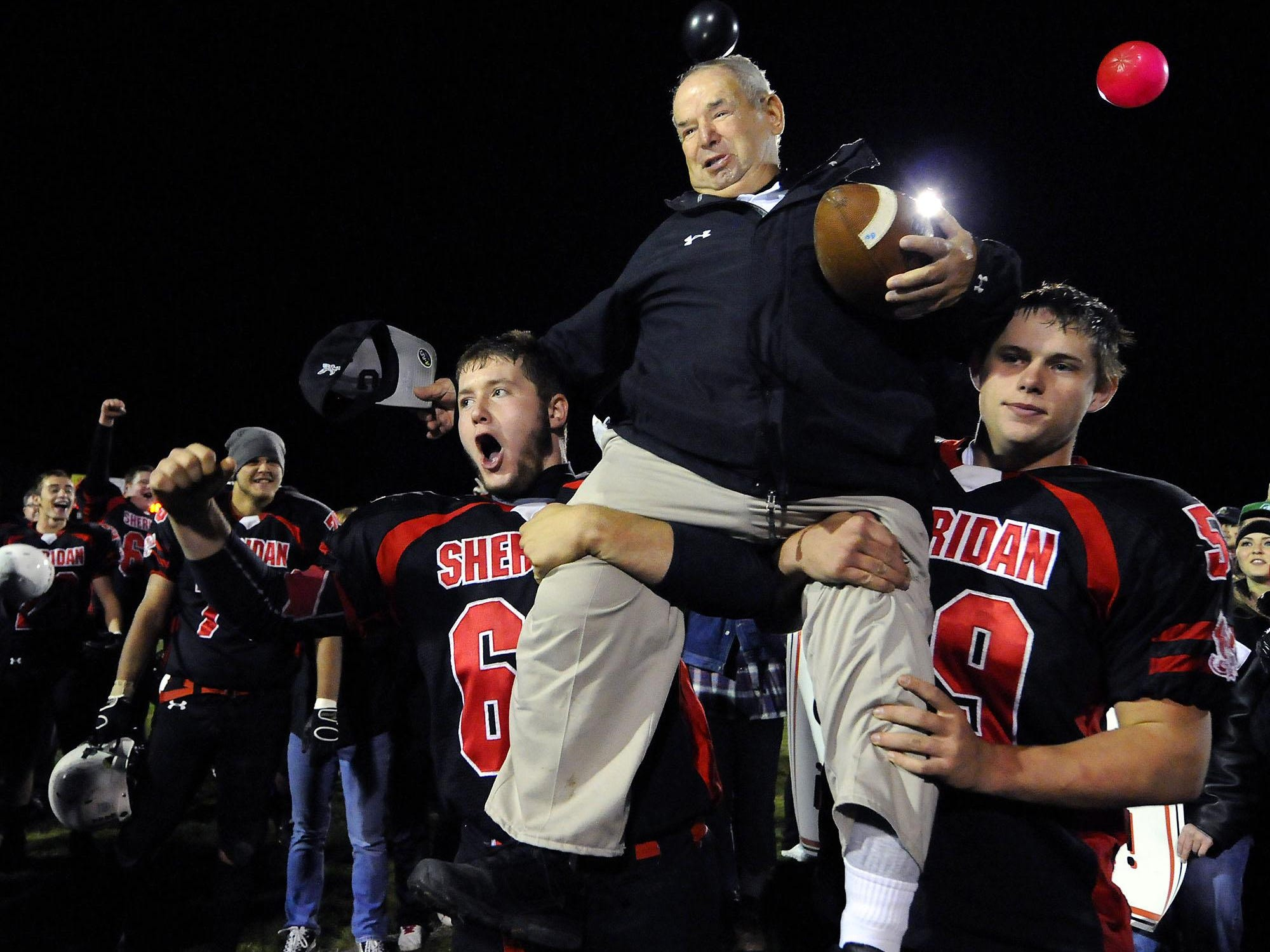 Sheridan players carried Bud Wright off the field after he became Indiana's winningest coach in 2011 with 369 victories. Eight wins with the team this year would bring him to 400 wins.