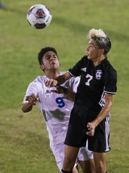 Mariner High School midfielder Nicco heads a pass against