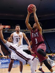 Troy guard Wesley Person (3) goes to the basket against Texas State guard Ojai Black during the Sun Belt Conference NCAA college basketball championship game in New Orleans, Sunday, March 12, 2017. (AP Photo/Gerald Herbert)