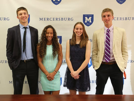 Four Mercersburg Academy student-athletes pose after