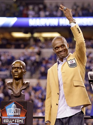 Former Indianapolis Colts Marvin Harrison  shows off his Pro Football Hall of Fame rings at halftime of the Colts game Thursday, November 24, evening at Lucas Oil Stadium.