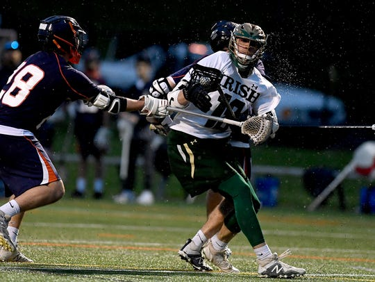 Cole Witman, seen here in a file photo, has helped the York Catholic boys' lacrosse team to a 9-0 start through Monday's games.