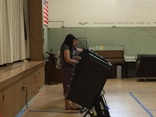 Voters use polling machines on Primary Election Day