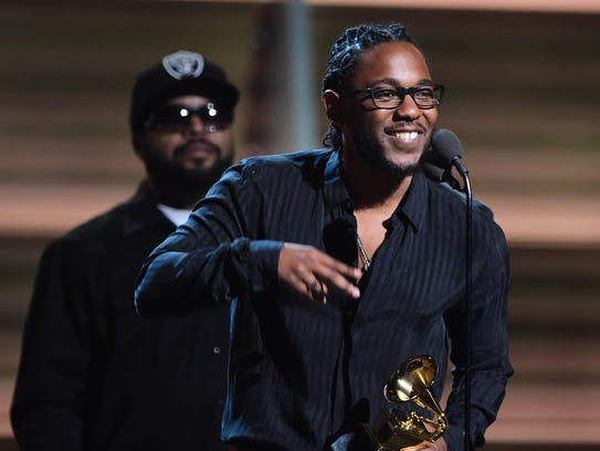 Kendrick Lamar (R) receives the award for the Best
