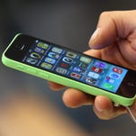An Apple iPhone is seen on September 20, 2013.