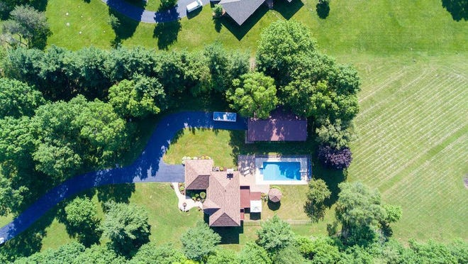 This home is nestled on five acres of land located at 227 Spring Brook Road, Rockford.