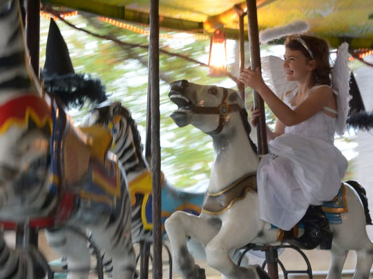 """Cheyenne Pellerin, 7, rides the """"Carou-Spell"""" carousel during the annual ZooBoo at the Hattiesburg Zoo Oct. 23. ZooBoo is open 5:30-8pm from October 23-31, admission is $10 per person and includes unlimited train rides on the ÒSpooktackular Express."""" Tickets to ZooBoo are available for advance purchase at HattiesburgZoo.com. Tickets will also be available at the Zoo each night of ZooBoo beginning at 5:30pm. For more information, visit HattiesburgZoo.com."""